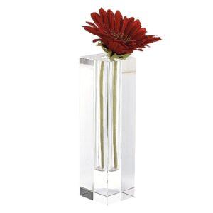 rectangular crystal vase that holds a single flower