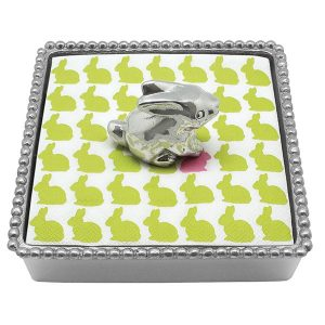 Silver beaded napkin box with silver bunny weight on top of napkins with green bunny print