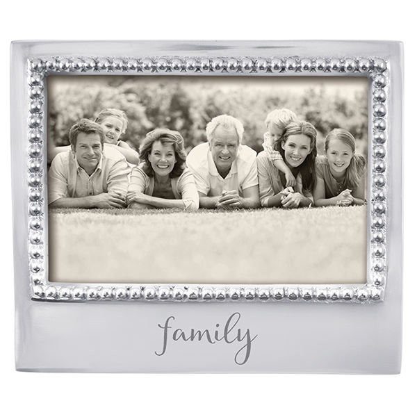 Silver beaded frame with the word family written in script at the bottom