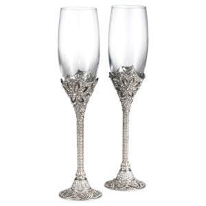 "Olivia Riegel <a href=""https://lifestylesgiftware.com/product/olivia-riegel-silver-windsor-flute-set-of-2-7-oz/"">Silver Windsor Champagne Flutes</a>"
