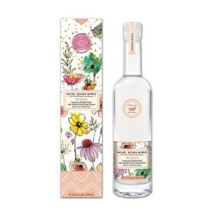 Bottle of bubble bath and box with illustrated flowers