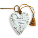 white floral ornamental heart with gold tassel and key