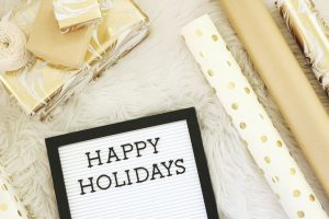 Happy Holidays with golden gifts and wrapping paper