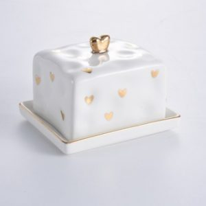 White butter dish with small gold heart pattern