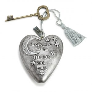 Silver heart with key attachment that reads Love you to the moon and back